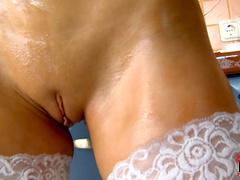 Brunette Joselyn rubs her oiled pussy