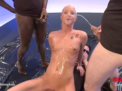 Hot redhead beauty is playing with urine