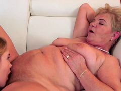 Young blonde gets busy with a horny granny