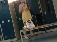 Sexy small-tit babe is standing in the locker room