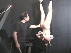 Gagged and bound submissive toy in dungeon