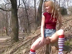 Sexy outdoor solo scene with long-haired blonde