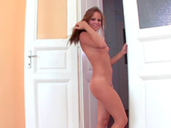 Slender blonde Monica Sweet shows off her long legs