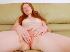 Cute redhead babe is poking her lovely puss