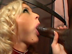 American blonde is sucking black dick in the cage