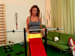 Cute babe Krisztina Ventura makes is pressing a barbell