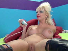 Fake-tit blonde and her gigantic pink dildo