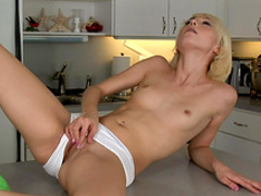 Horny slender blonde in boots is playing with vaginal toys