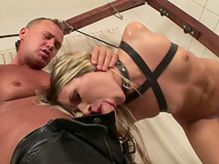 Pretty blonde gives a BDSM blowjob