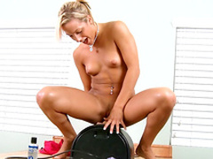 Blonde MILf Karanovak is sitting on the dildo