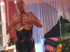 Busty blonde with trimmed pussy is posing