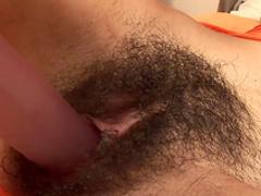 Hardcore brunette is penetrating her puss