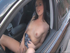 Beauty is masturbating her shaved puss in the car