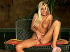 Busty blonde babe in bikini Adelle takes some toys