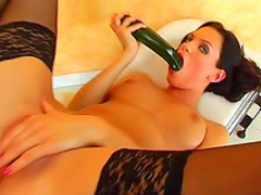 Natural tits Olivia Y is fucking a cucumber on camera