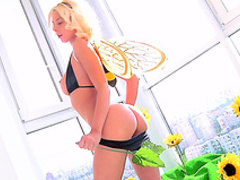 Blonde Maya F shows off her juicy ass