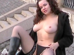 Busty curly brunette is fucking her pussy