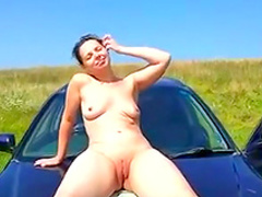 Busty babe is sucking dick in front river