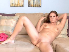 Solo girl Michele is lying with spread legs