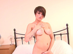 Busty young brunette Natalie takes off her shirt