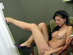 Erotic brunette Leeann shows off her boobies