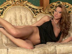 Pretty brunette Cindy Hope is masturbating on the couch