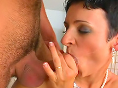 Dark-haired Lola is sucking a horny dick