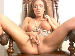 Pornstar Harley Kent masturbates her shaved pussy