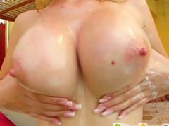Slutty busty blonde is playing with her pink puss