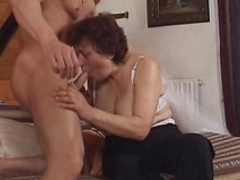 Slutty mature is sucking this young dick