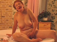 Granny is fucking with a nice young dick