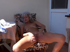 Granny blonde is touching her shaved pussy