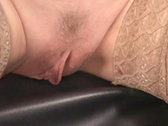 Mature blonde is playing with trimmed pussy