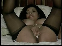 Stripping ang playing dildo in bed