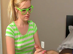 Spicy blonde gives a nice teen handjob