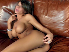 Dark-haired slender pornstar shows off her body
