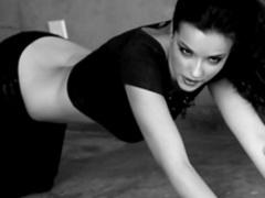 Alluring brunette in high heels poses naked