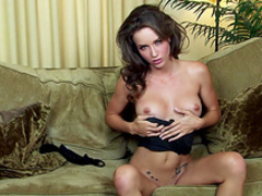 Malena Morgan is rubbing her shaved pussy
