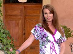 Pretty slender brunette is posing naked outdoors