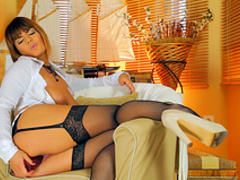 Business woman in stockings is masturbating