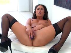 Busty brunette demonstrates her juicy ass