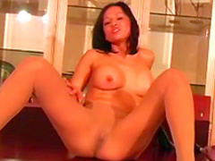 Asian cutie is playing with her shaved pussy