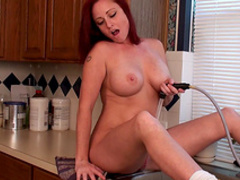 Slender redhead milf with big natural tits shows herself