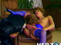 Curly-haired chick is fucking after blowjob