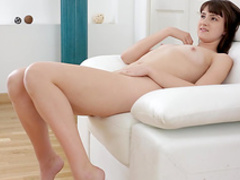 Teen with shaved puss is fingering her puss
