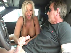 Blonde with nice face is masturbating his cock in the car