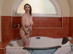 Slender soapy brunette Karina Heart is washing her tits