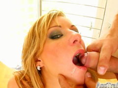 Spicy blonde is getting her holes double penetrated