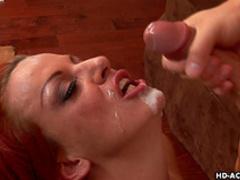 Redhead pornstar with big tits receives creampie