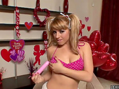 Blonde in pigtails inserts dildo in her pussy